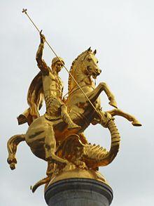 Saint Santori terrassant un dragon hébété