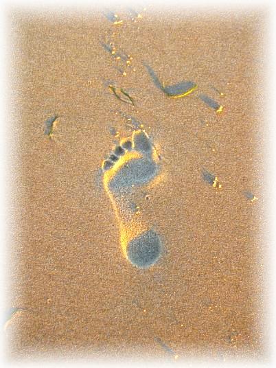 empreinte de pied dans le sable